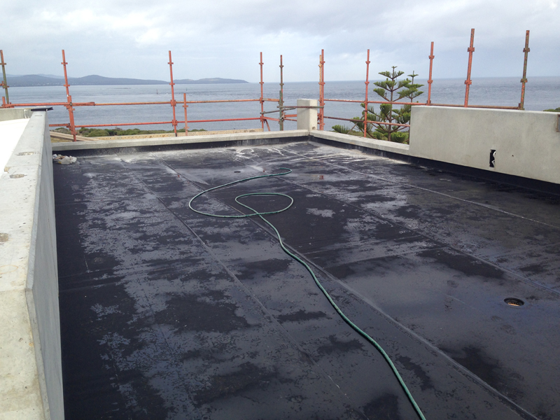Roof terrace which has been covered by a Butynol ( rubber ) membrane which provides additional water proofing for the concrete roof