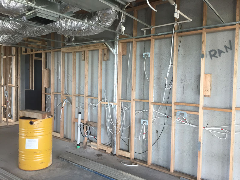 Plumbing and electrical services have been roughed-in prior to plastering commencement